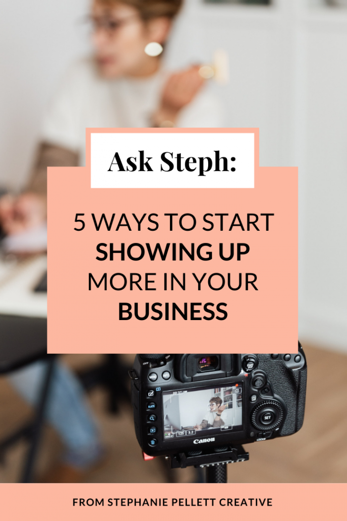"Background image of a woman sitting at a desk with a camera filming her. The graphic text on top says ""Ask Steph: 5 Ways to Start Showing Up More in Your Business"" At the bottom of the image it says ""From Stephanie Pellett Creative"""